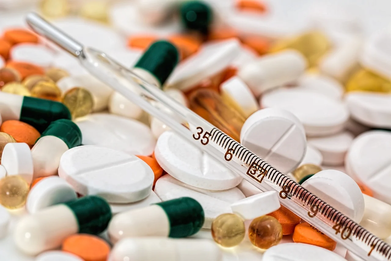 thermometer on a bunch of pills